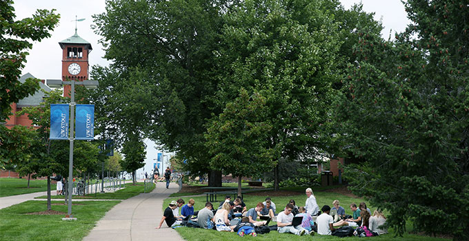 Photo - students enjoy a class held outdoors on campus